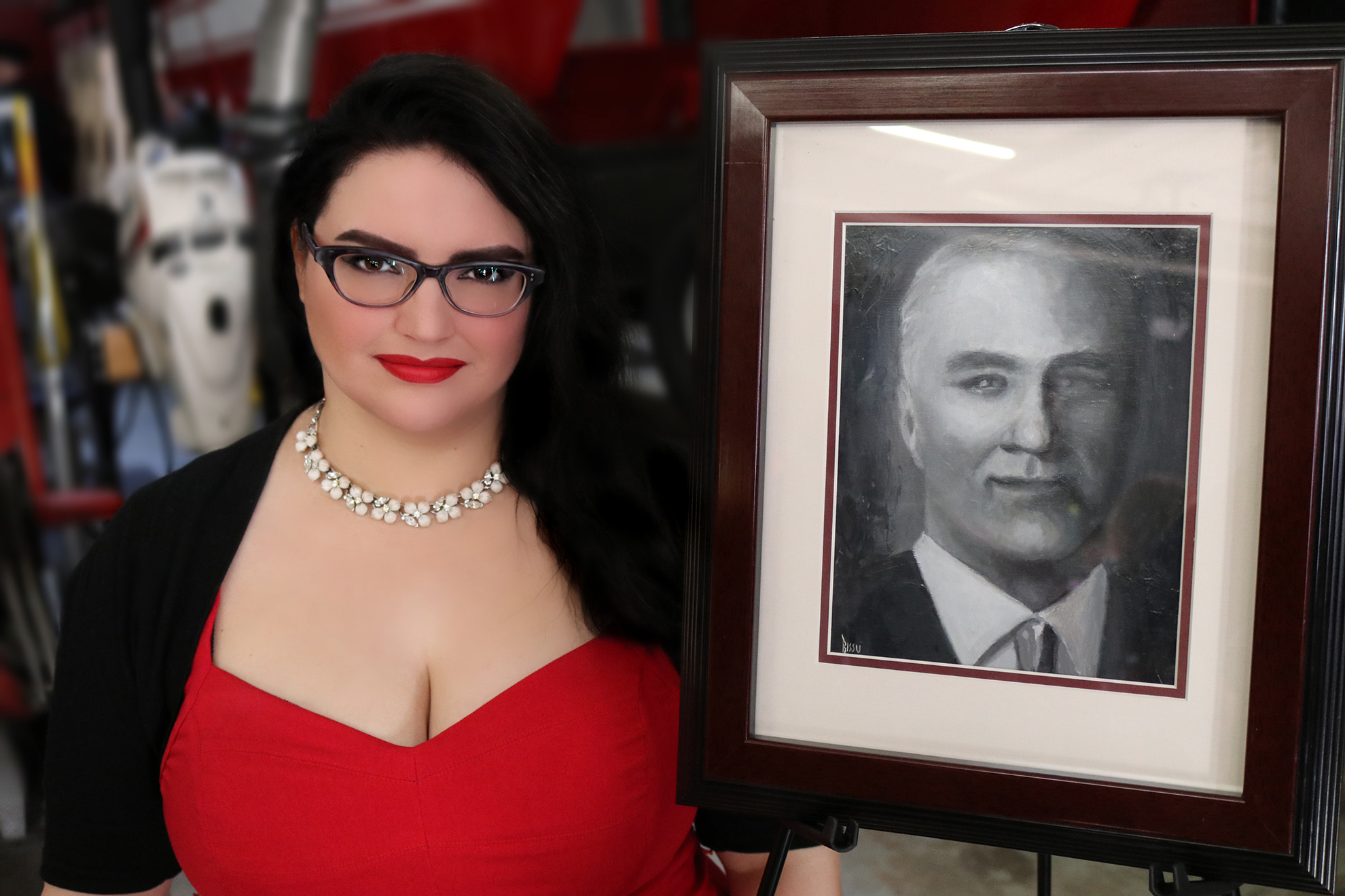 Artist Jen Bissu with her oil portrait of fallen hero, Firefighter Robert Hamilton, at the dedication ceremony.