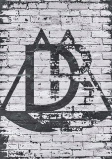DB logo on brick faded.jpg