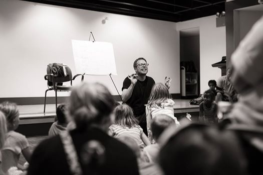 """Joe Theroux channels Russell Rat at the Newport Public Library during the """"Animal Olympics"""" storytelling program for the 2016 Rhode Island Summer Reading Program."""