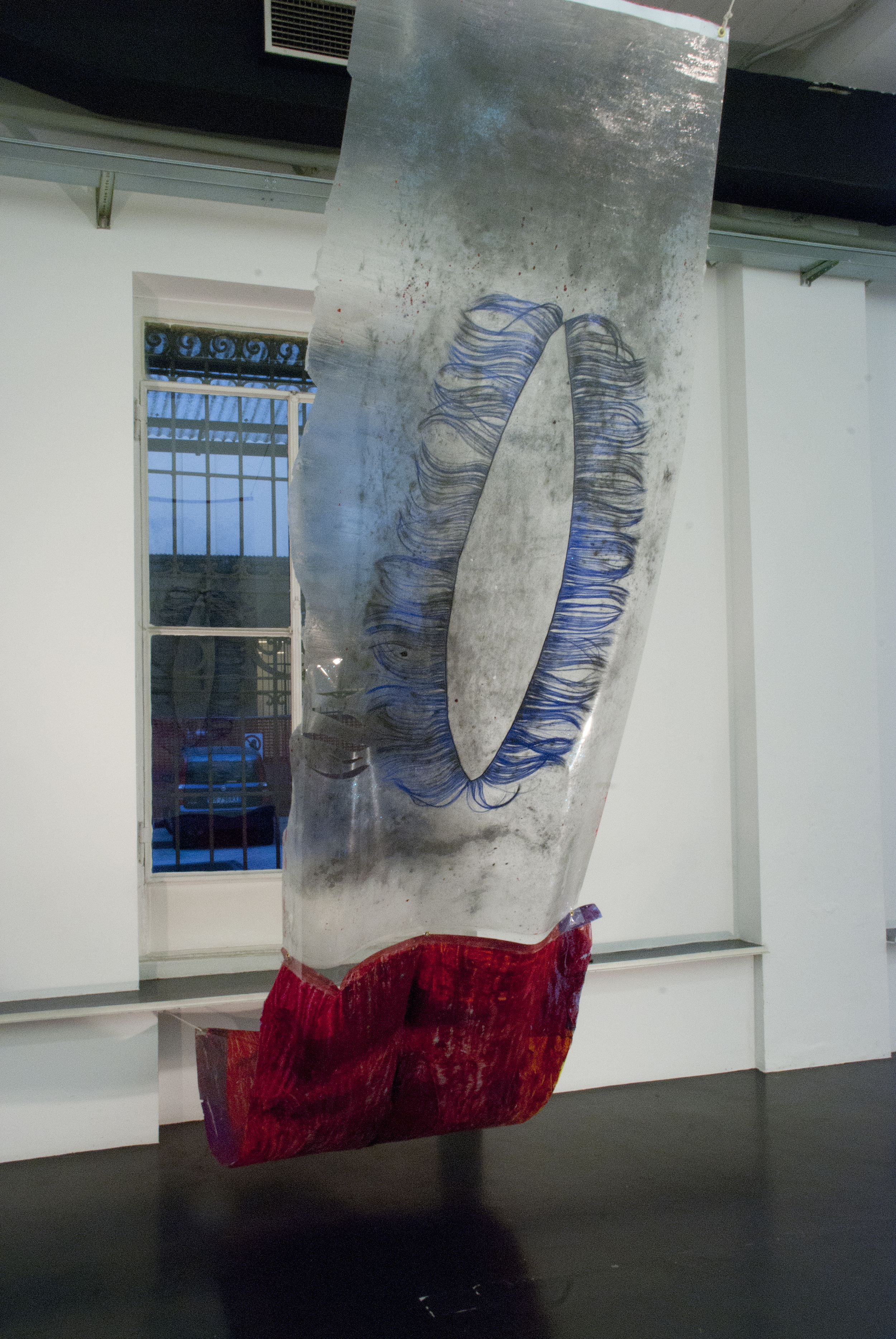OZ_My Left Eye Is Your Mouth (The Left Side of the Canal) Acetate, wig, acrylic, paint, glitter, plaster, leaves, graphite, traces and indexes of organic matters in Vermont and the artist's studio floor in Vermont. 102 cm x 438 cm 2015 .jpg