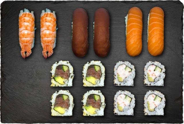 2.stk Nigiri m. laks, 2.stk Nigiri m. tun, 2.stk Nigiri m. reje, 4.stk Califonia, Indside-Out Maki, 4.stk Spicy Tun og 4.stk Indside-Out Maki.