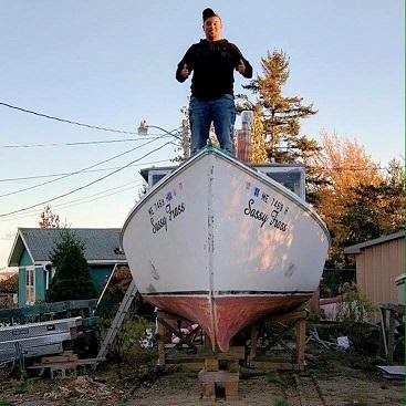 Zachary Floyd on his boat, F/V  Sassy frass.