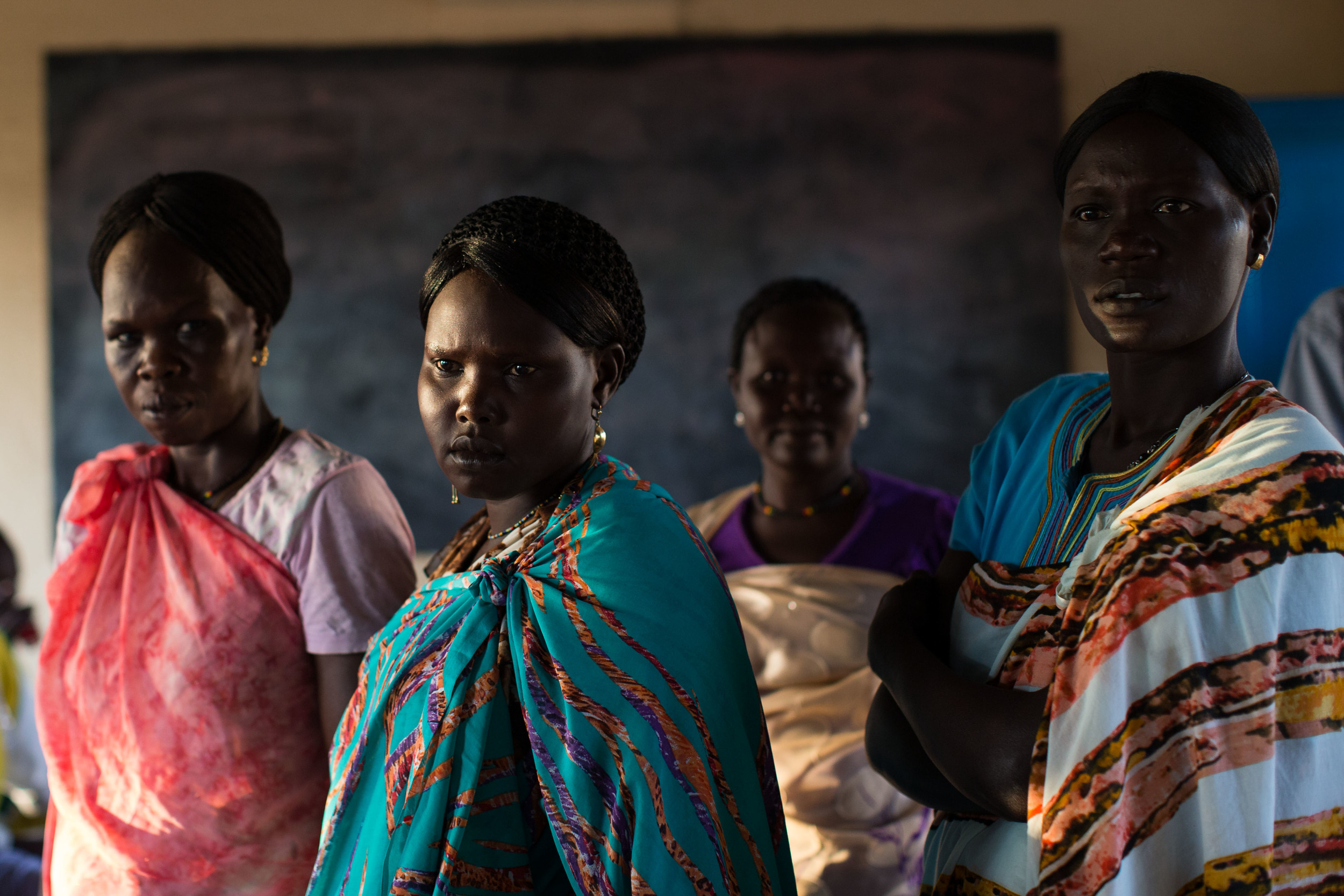 Women wait to vote at an abandoned school converted into a voting center in Abyei.