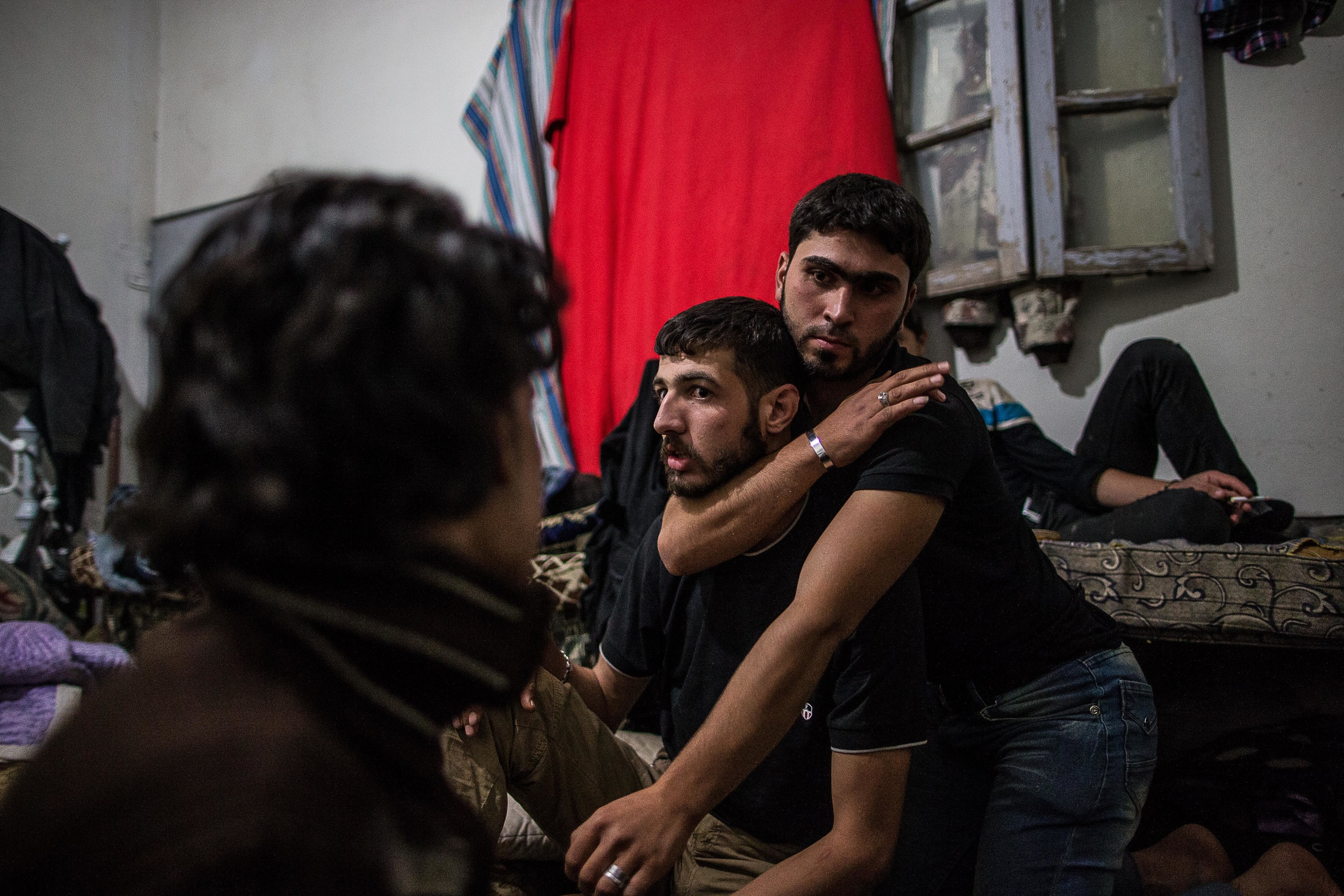 Another rebel named Hassan instructs others how to break someone's neck hours before they carry out a night raid on the other side of the wall.