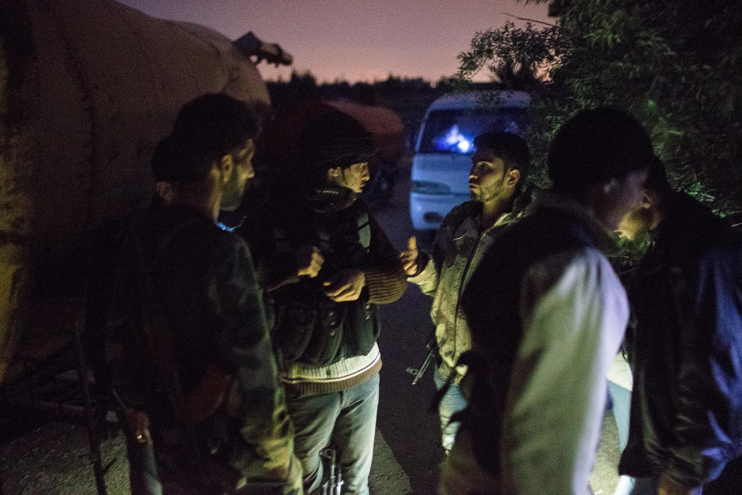 Rebels coordinate the plan of attack before a night operation over the wall.