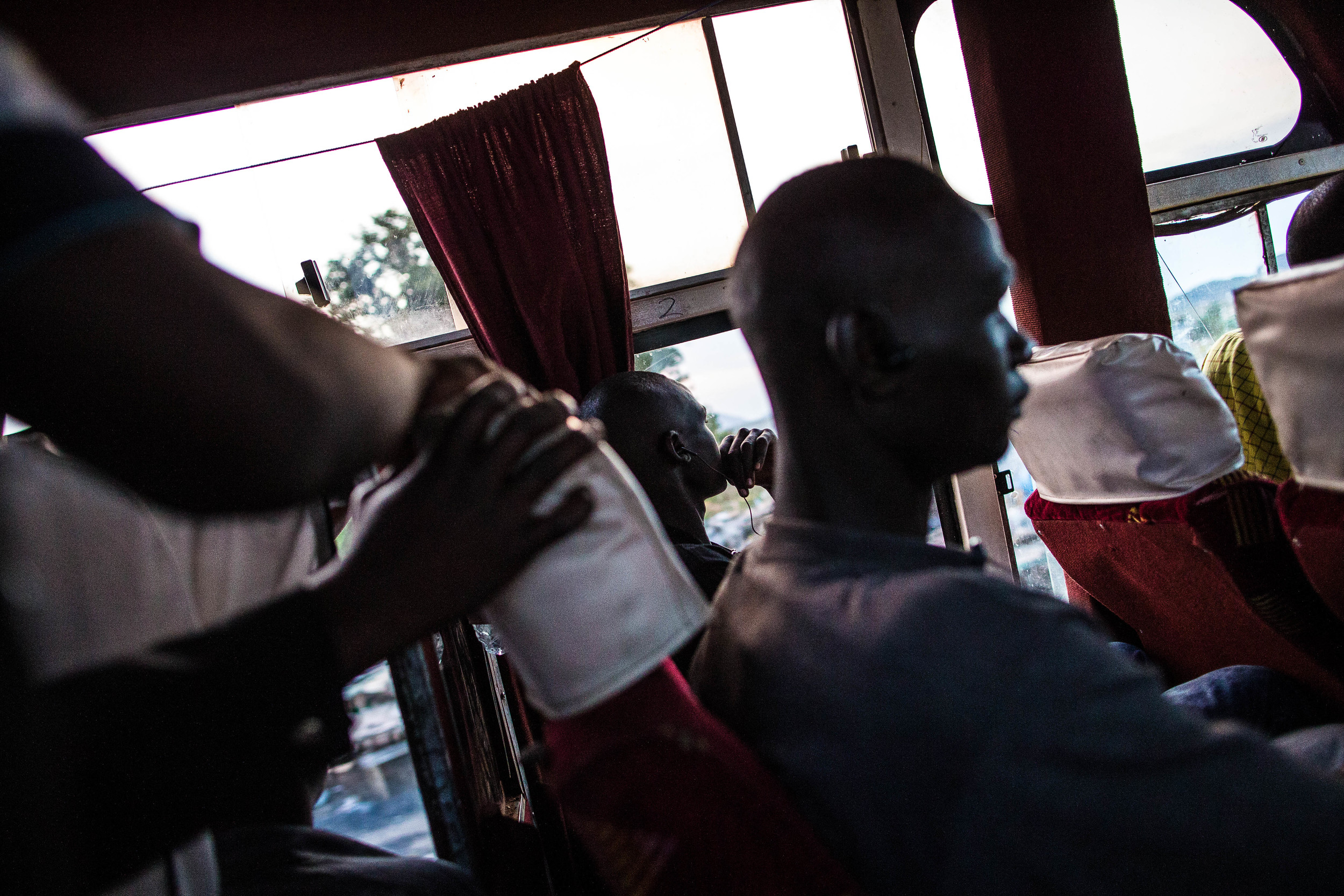 "Izekal, looks out the window as the bus heads toward Kampala. When asked why he started to fight, he replies ""...because I wanted to be strong and do more with life."""