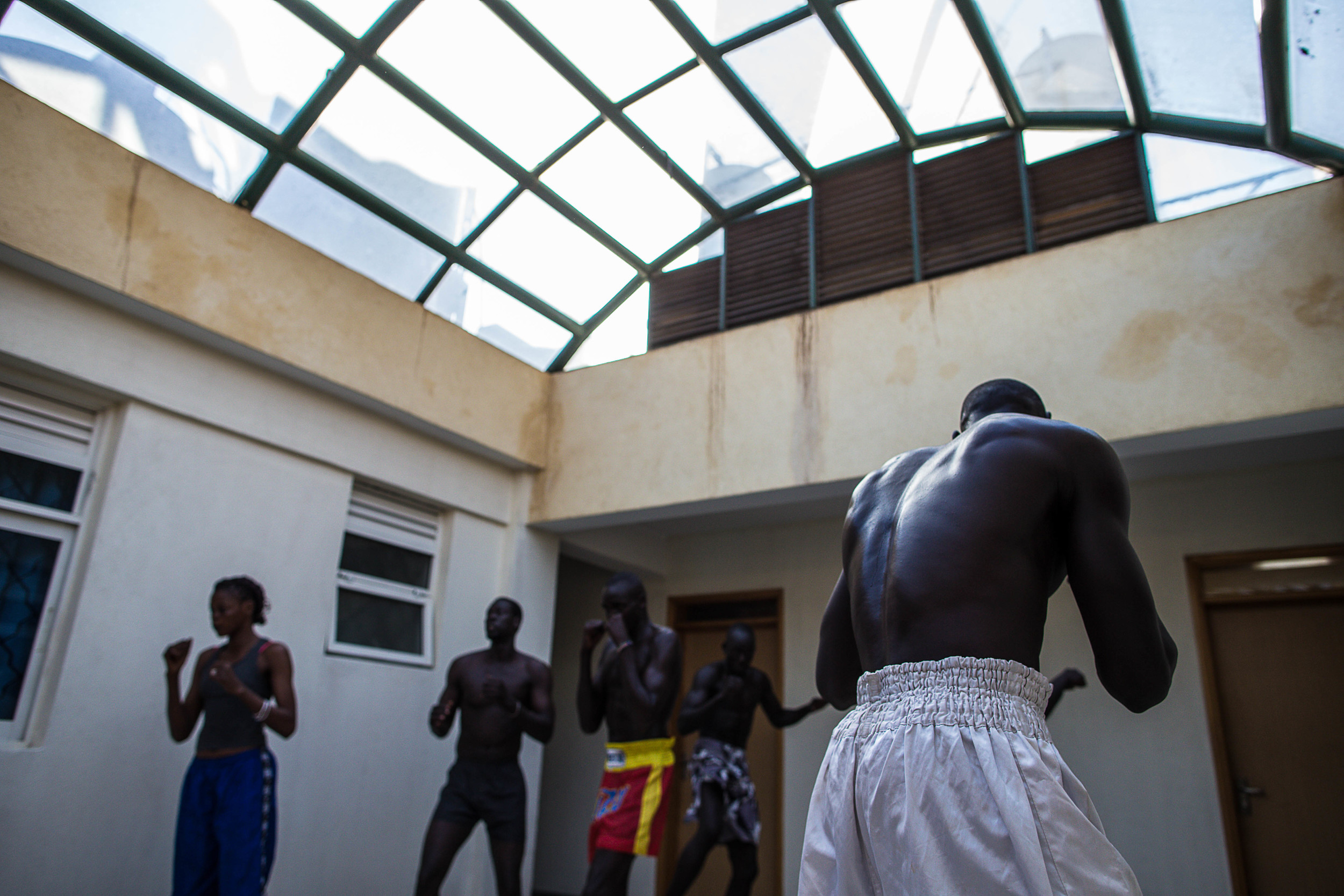 Fighters practice in an atrium of the hotel.