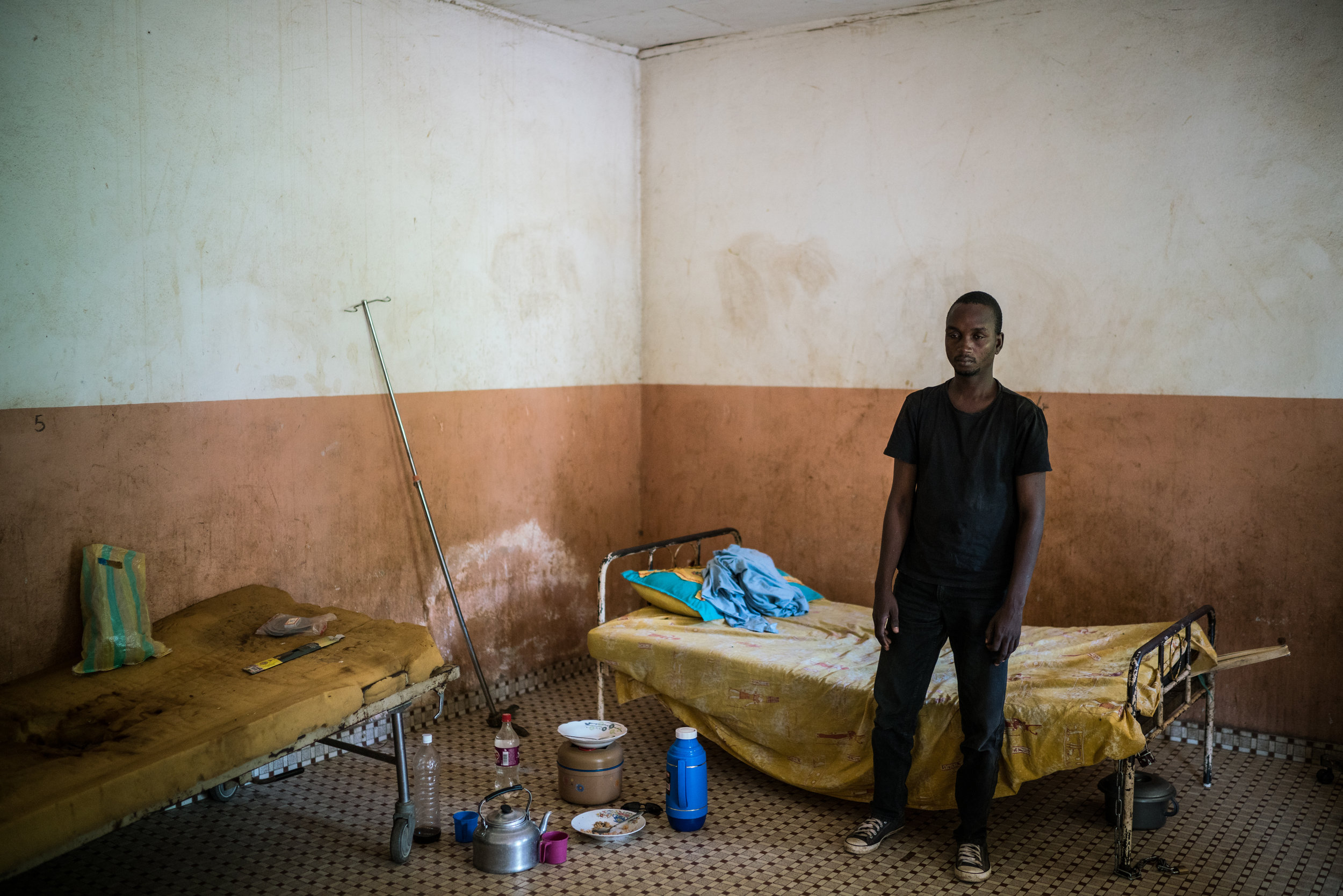 Maman Boubacare, 31, shuffles from his bed in the psychiatric ward of the regional hospital in Garoua, Cameroon. Maman's brother brought him to the hospital after Maman's mental and physical health detoriorated from what his brother and doctors have said was an increasingly large array of drugs taken including tramadol.