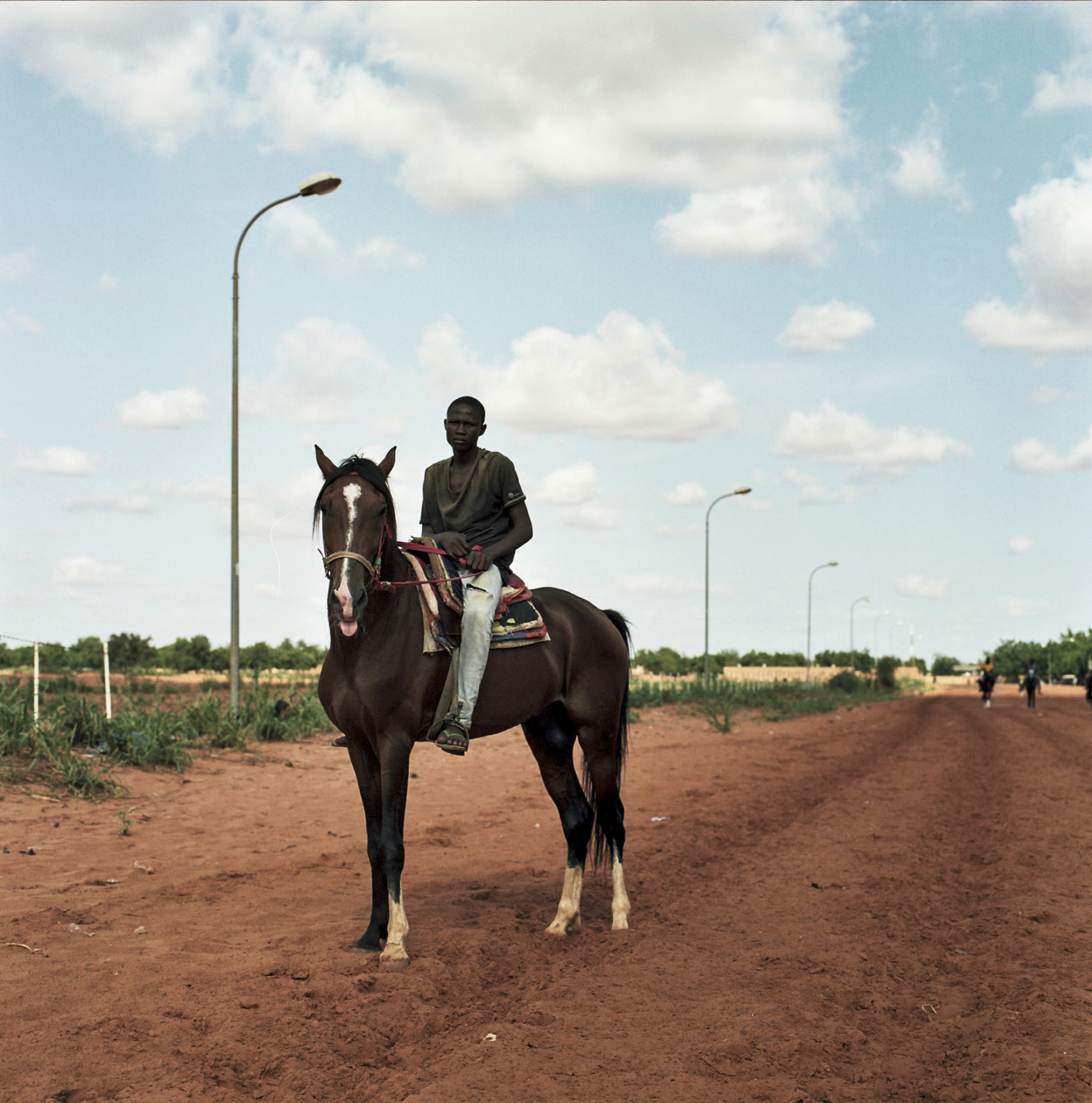 """Yussef, 14, has been riding and racing horses since he was eight. """"I want to ride my whole life,"""" he says from the saddle of his horse, """"I can fly with the horse."""""""