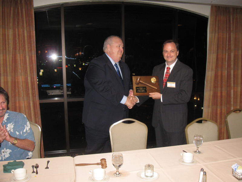 Outgoing President Matt Kalus being given his gavel.jpg