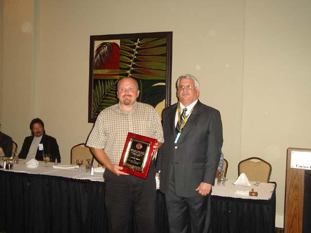 Cadastralist of the Year award winner Robert Miller with President John Bausola.jpg