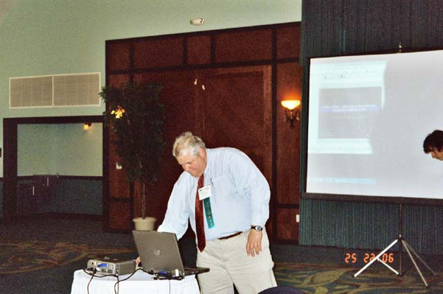 William Holland sets up for his keynote address.jpg