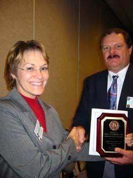 Ellen Edwards receiving award for immediate past president.jpg