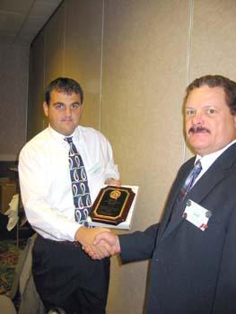 Wayne Costin receiving Directors award .jpg