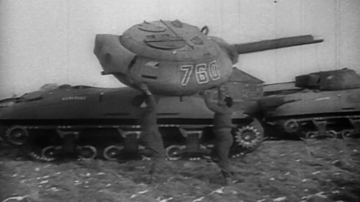 [Men assembling an inflatable tank. Courtesy of Rick Beyer. From the documentary, The Ghost Army ]