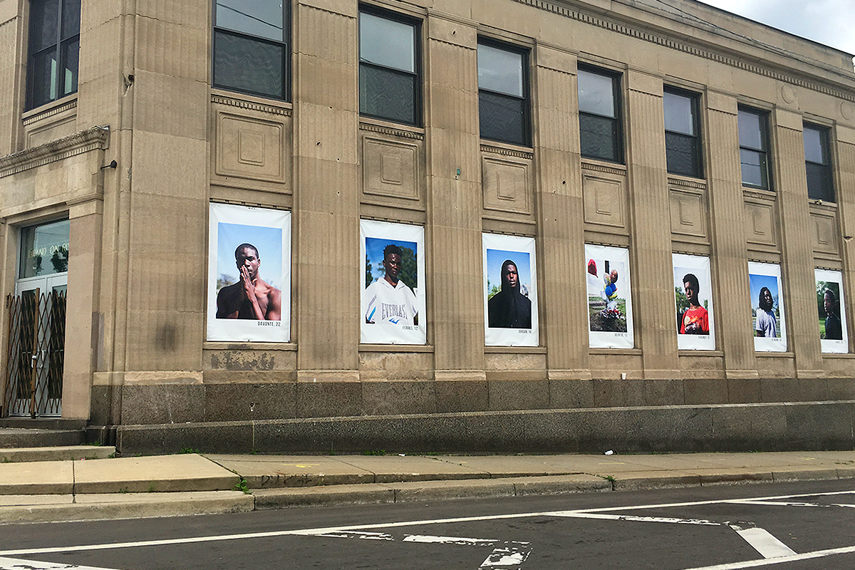 Powerful photo installation seen while driving in Detroit. Author unknown.