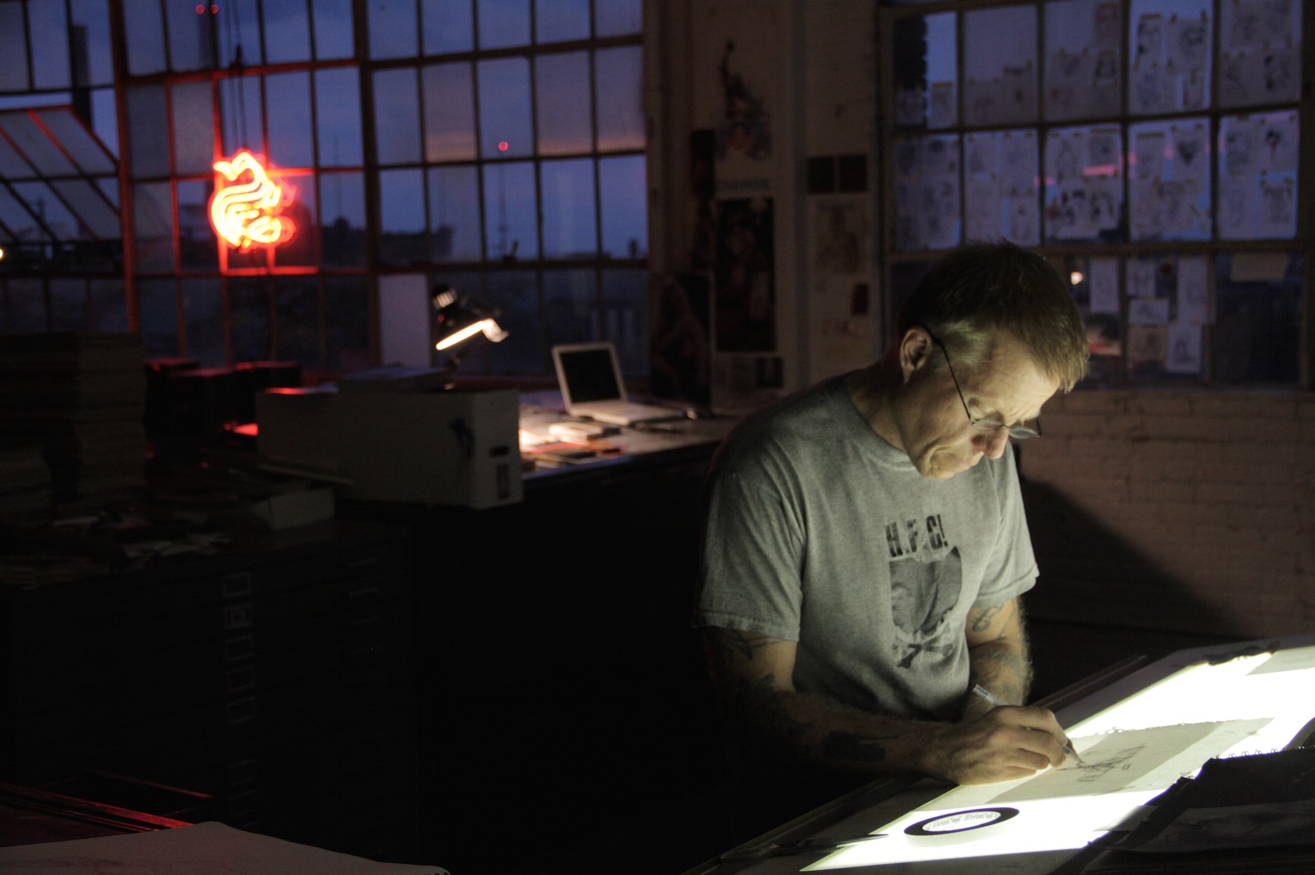 Derek Hess drawing in his studio