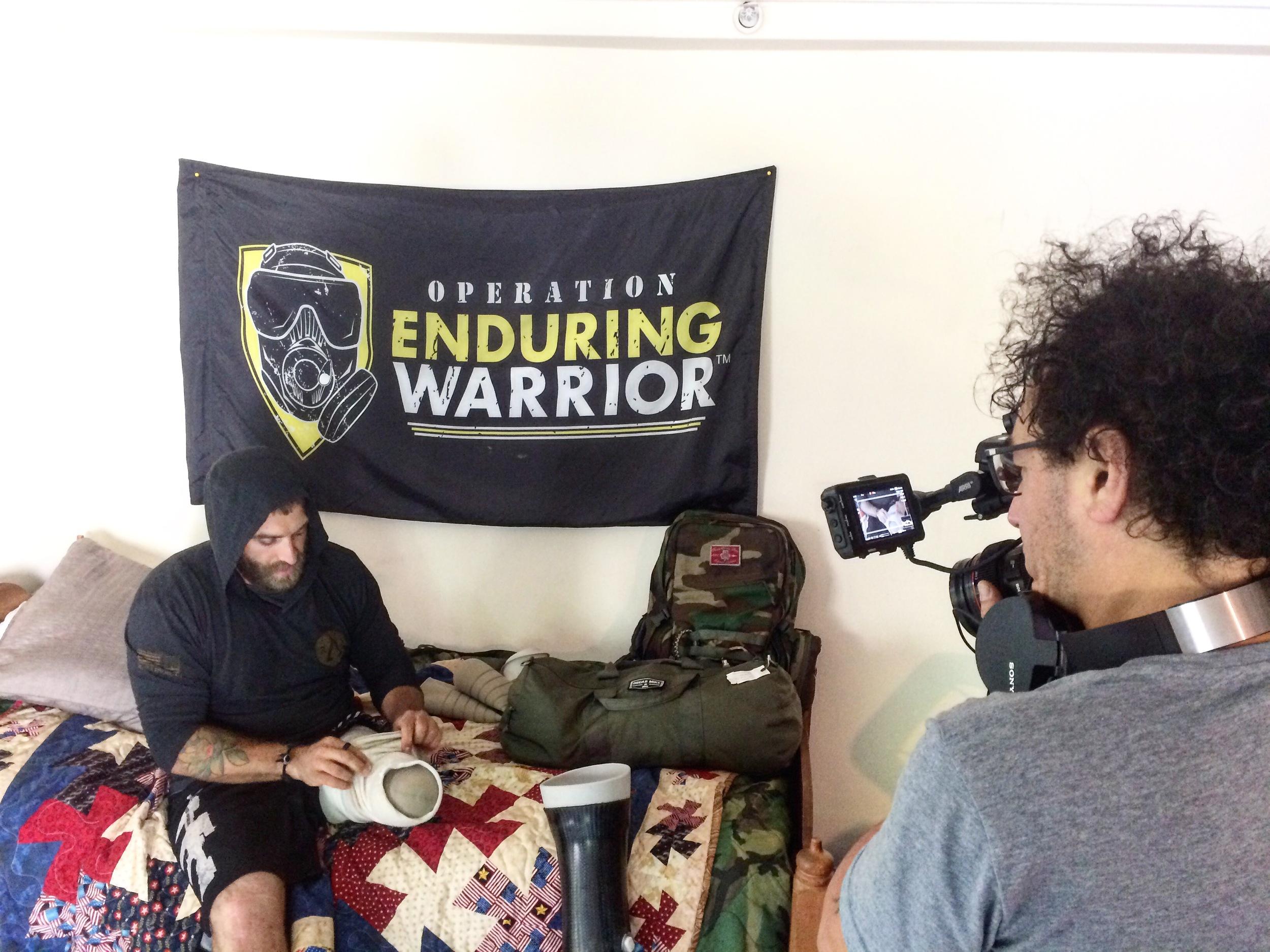 Cinematographer Nicola Raggi capturing Earl during the intimate moment of changing his walking leg to his running leg.