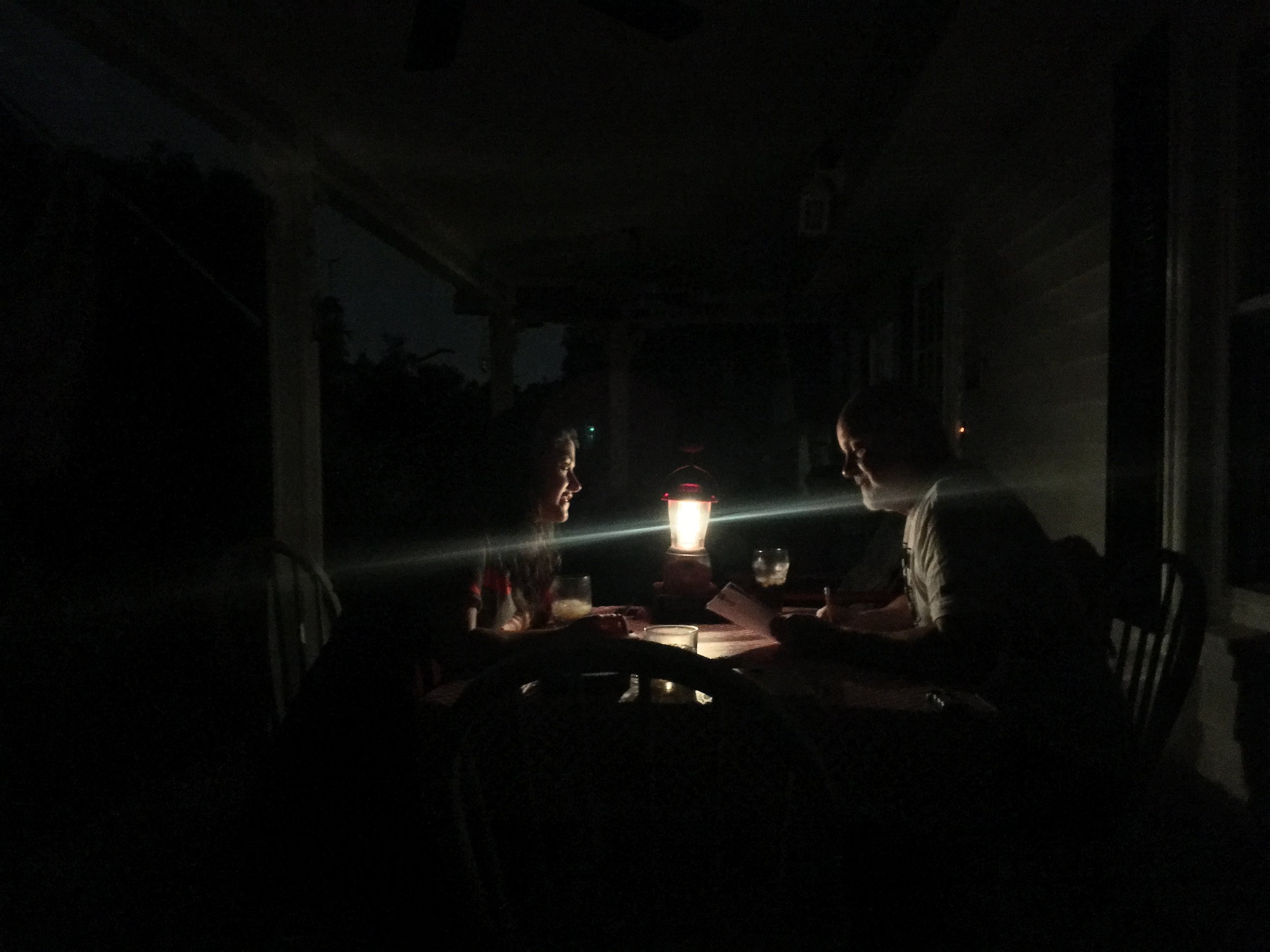 Taken on my iPhone with single light source. Dad kicking ass in Yahtzee.