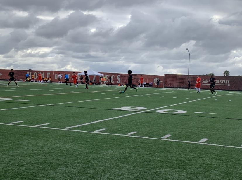 action midfield kick.png