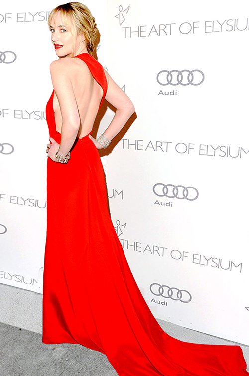 """""""Fifty Shades Darker"""" Star, Dakota Johnson in a Romona Red at The Art of Elysium's Heaven gala in Los Angeles."""