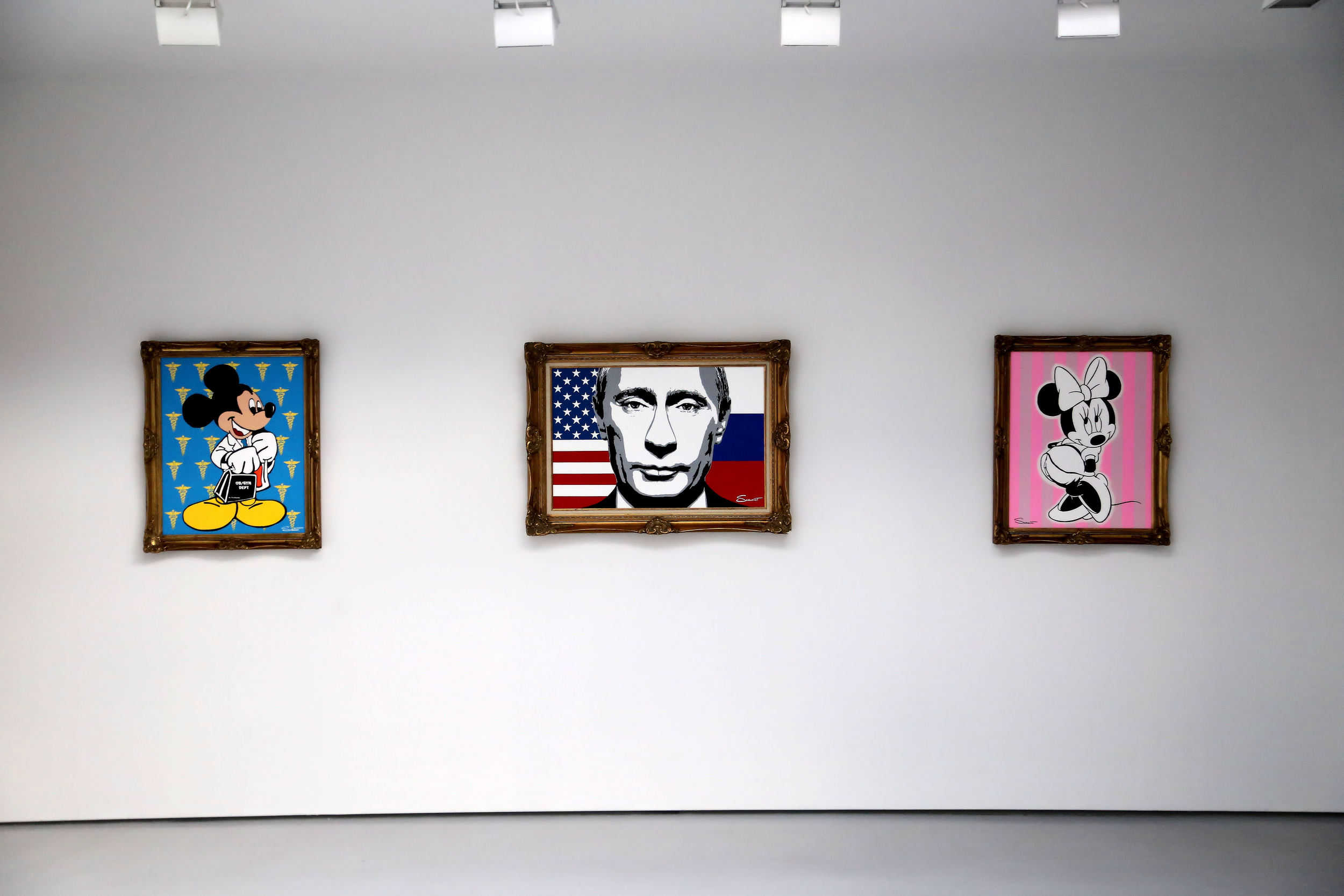 Putin Paintings with overhead lights.jpg