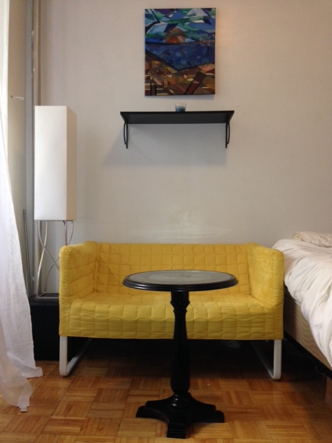 Yellow Ikea Couch = $99. Ikea Shelf = $14. Pier 1 Table = already owned. Pier 1 Lamp = already owned.