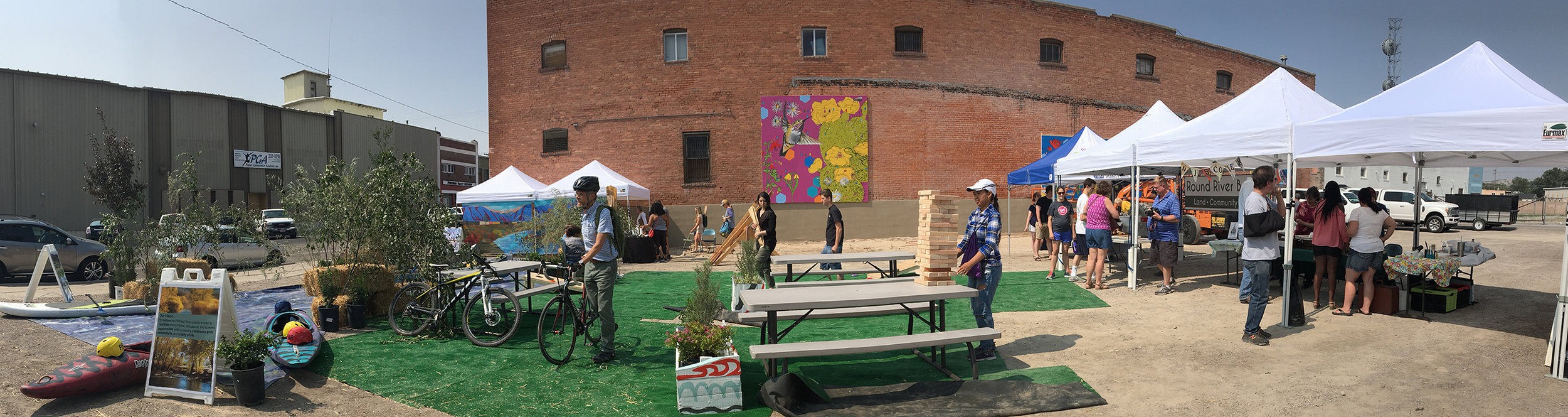 The Pop-Up Park had vendors, food, hydration station, public art, outdoor games, seating, landscaping, and a selfie stop.