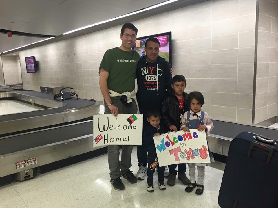 US. Army veteran/director Robert Ham, welcomes his interpreter Saifullah at the San Antonio Airport.