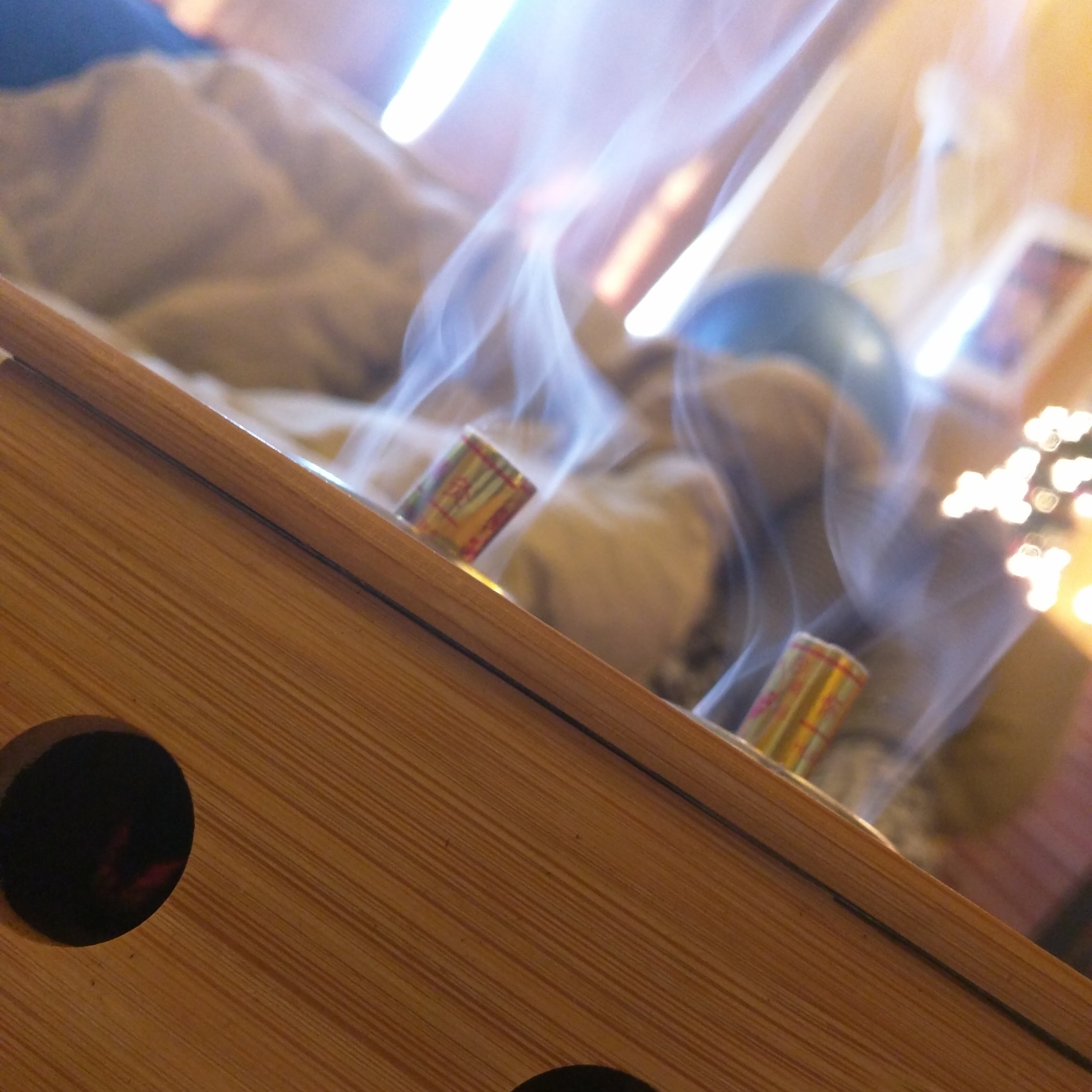 I use a special moxa box to hold sticks of burning herb over painful areas
