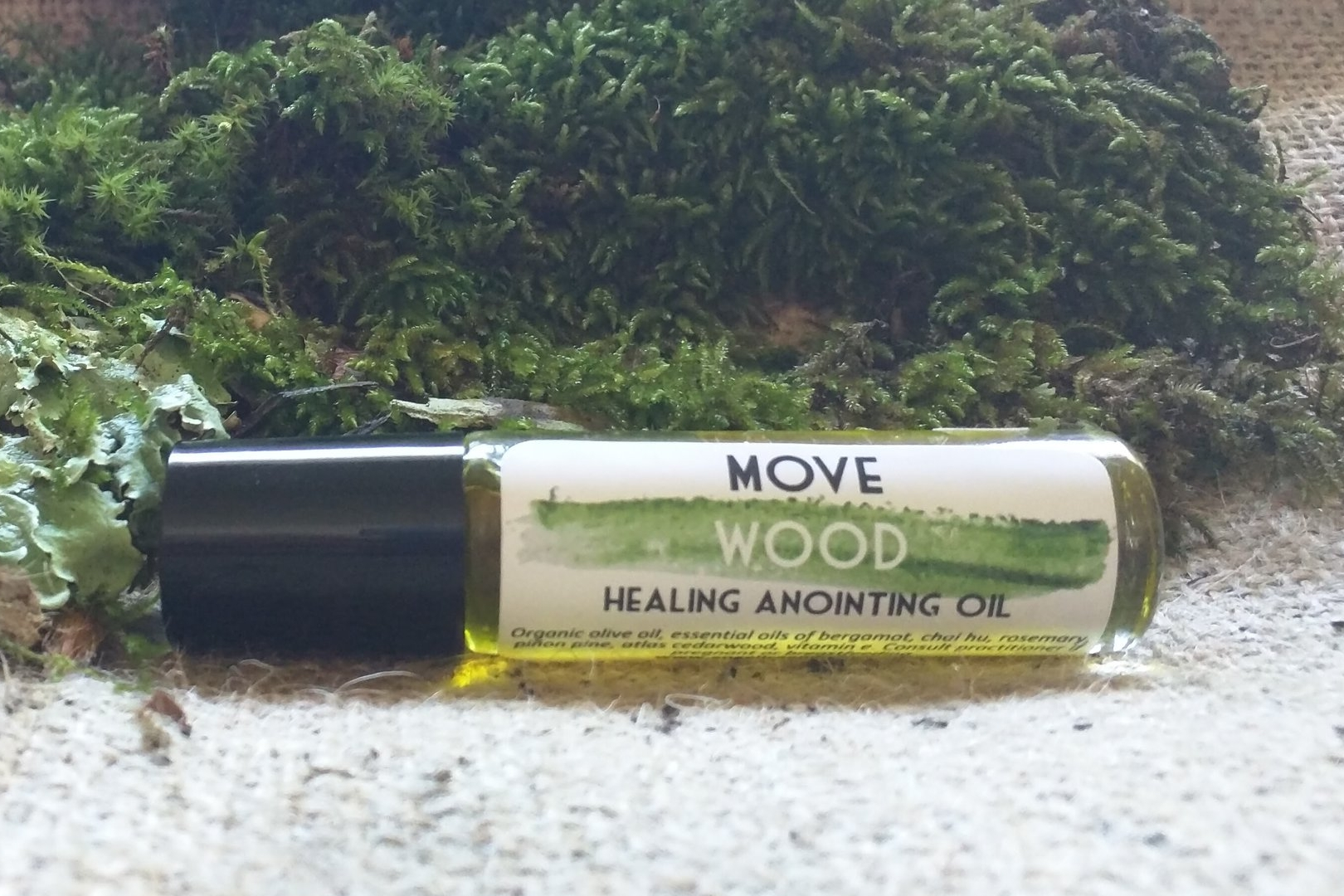 MOVE Wood Healing Anointing oil contains essential oils for relieving and releasing stuck energy and emotions.