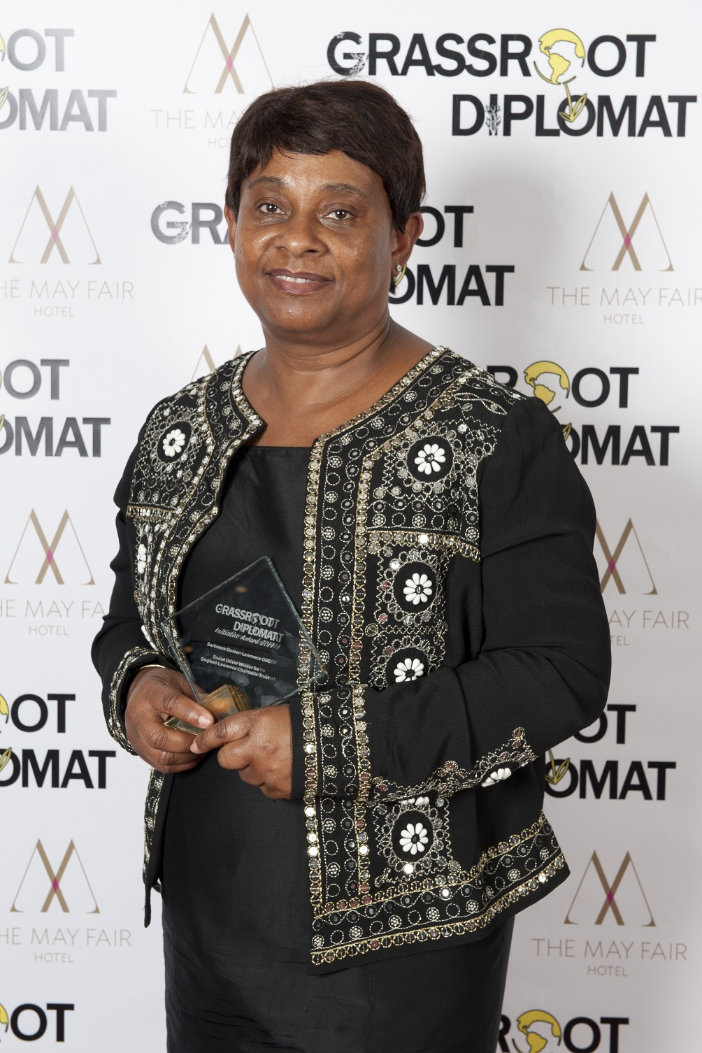 BARONESS LAWRENCE - HOUSE OF LORDS PEERSOCIAL DRIVER WINNER: STEPHEN LAWRENCE CHARITABLE TRUST2014A charity born out of a personal tragedy, Baroness Lawrence founded the Stephen Lawrence Charitable Trust following the murder of her son Stephen in 1993. The charity promotes a positive community legacy in her son's name and creates an environment of social inclusion and empowerment for youths in Britain. Her charity offers free training workshops to local communities in Lewisham, Greenwich and Southwark in providing young people with tangible skills and access to professions including music, media and law.
