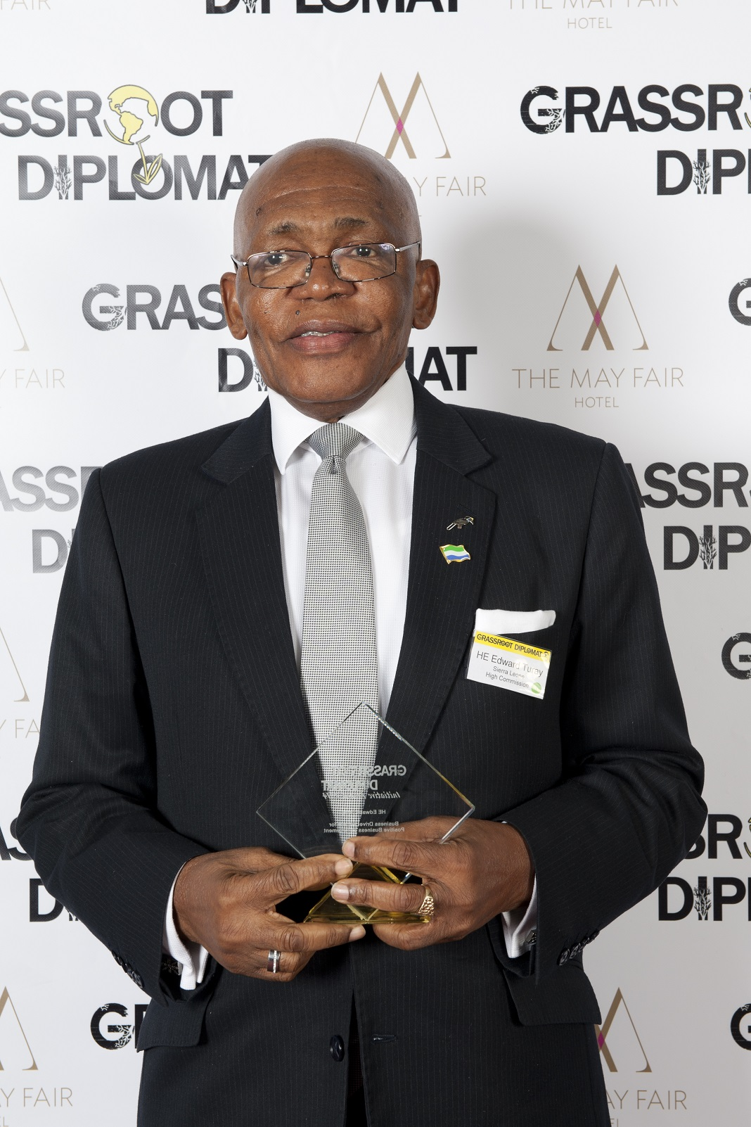 HE EDWARD TURAY - SIERRA LEONE HIGH COMMISSIONBUSINESS DRIVER WINNER: POSITIVE BUSINES ENFORCEMENT2014His Excellency Edward Turay of Sierra Leone has done remarkable work in galvanising diaspora communities across Europe, bringing better visibility to his country and people. With extremely stretched resources, the High Commissioner also heads diplomatic missions in Denmark, Norway, Sweden, Spain, Portugal, Cyprus and Ireland which he frequents to every two months. In the UK, the embassy manages a 100,000 people diaspora with 25,000 Sierra Leone civilians living in the London boroughs of Lambeth and Southwark alone.