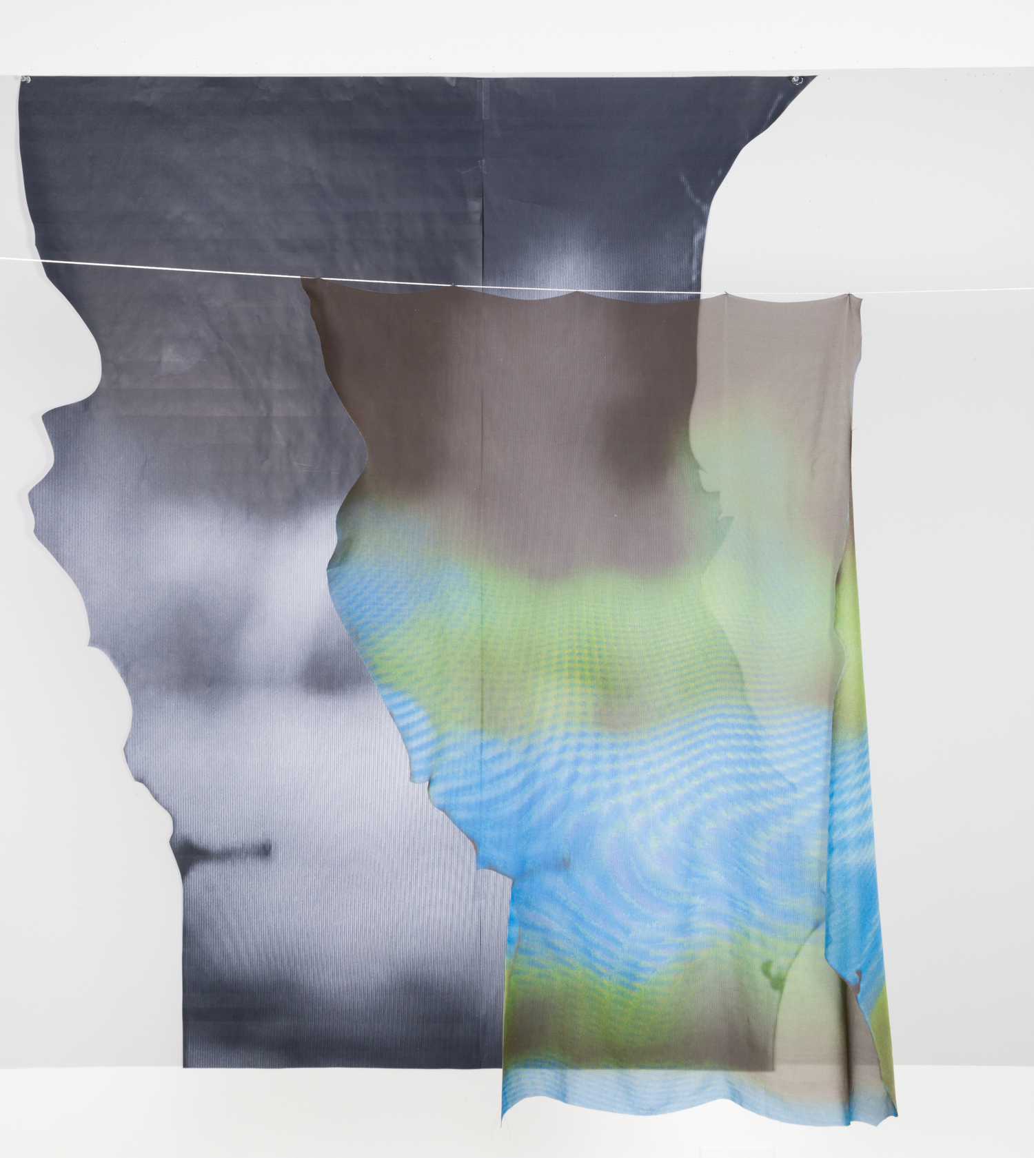 Untitled (Gaps), 2016, Digitally printed fabric, screen print on metalized film, and laundry line, 60 x 46 inches, dimensions variable.