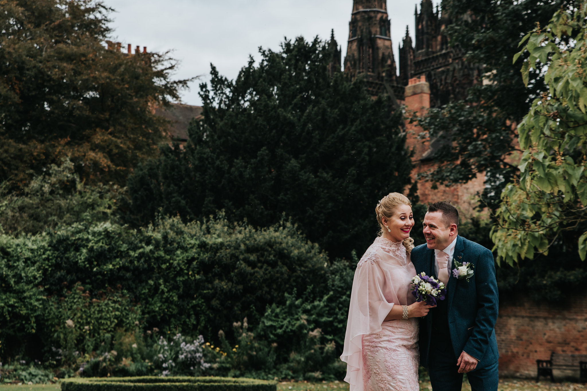 wedding-day-lichfield-cathedral-bride-groom-laughing-together