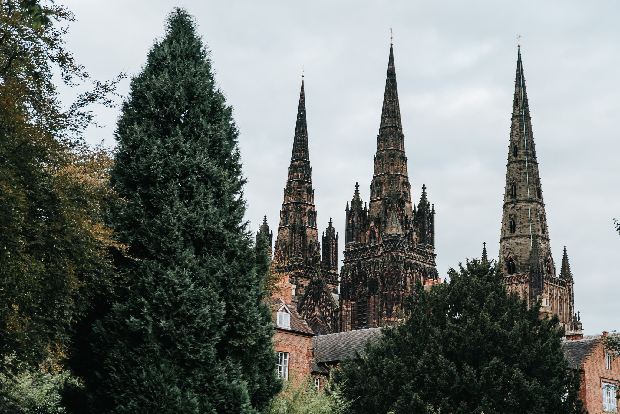 The 3 spires of Lichfield Cathedral in all it's glory on a cloudy day.