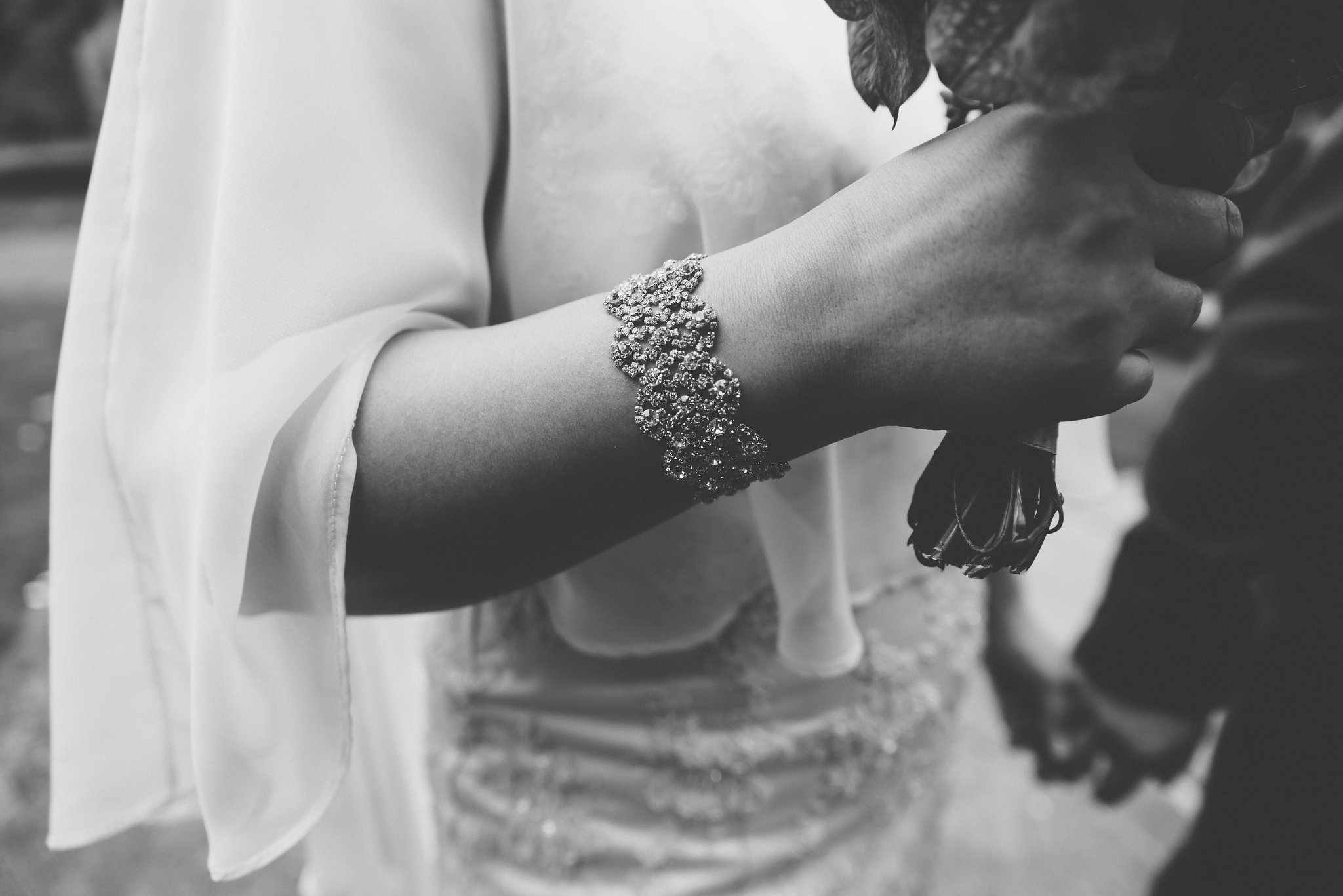 The bride is wearing an elegant bracelet.  The black and white treatment really shows off the detail of the jewellery.