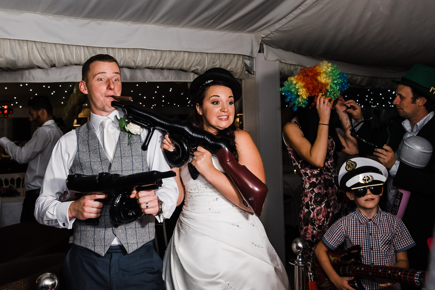 Bride and groom enjoy their photobooth during their wedding party at Moxhull Hall in Sutton Coldfield. The bride got ready at the Belfry Hotel and Resort.