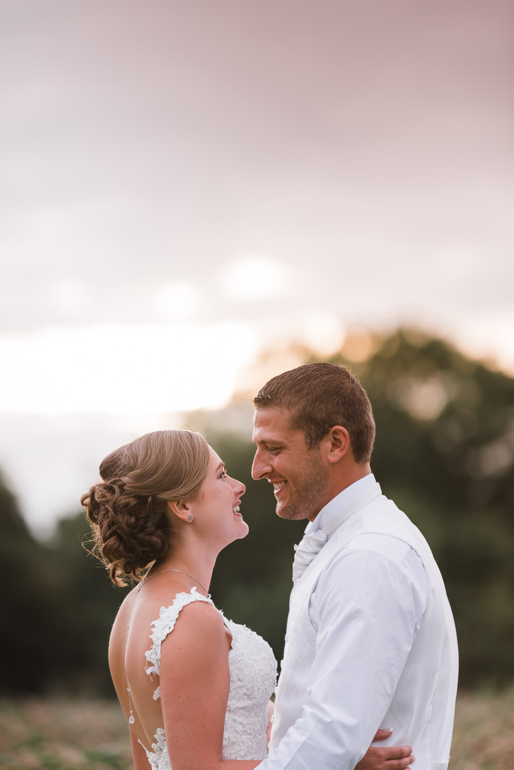 Newlyweds share an intimate moment at sunset during their evening party atat Wethele Manor.