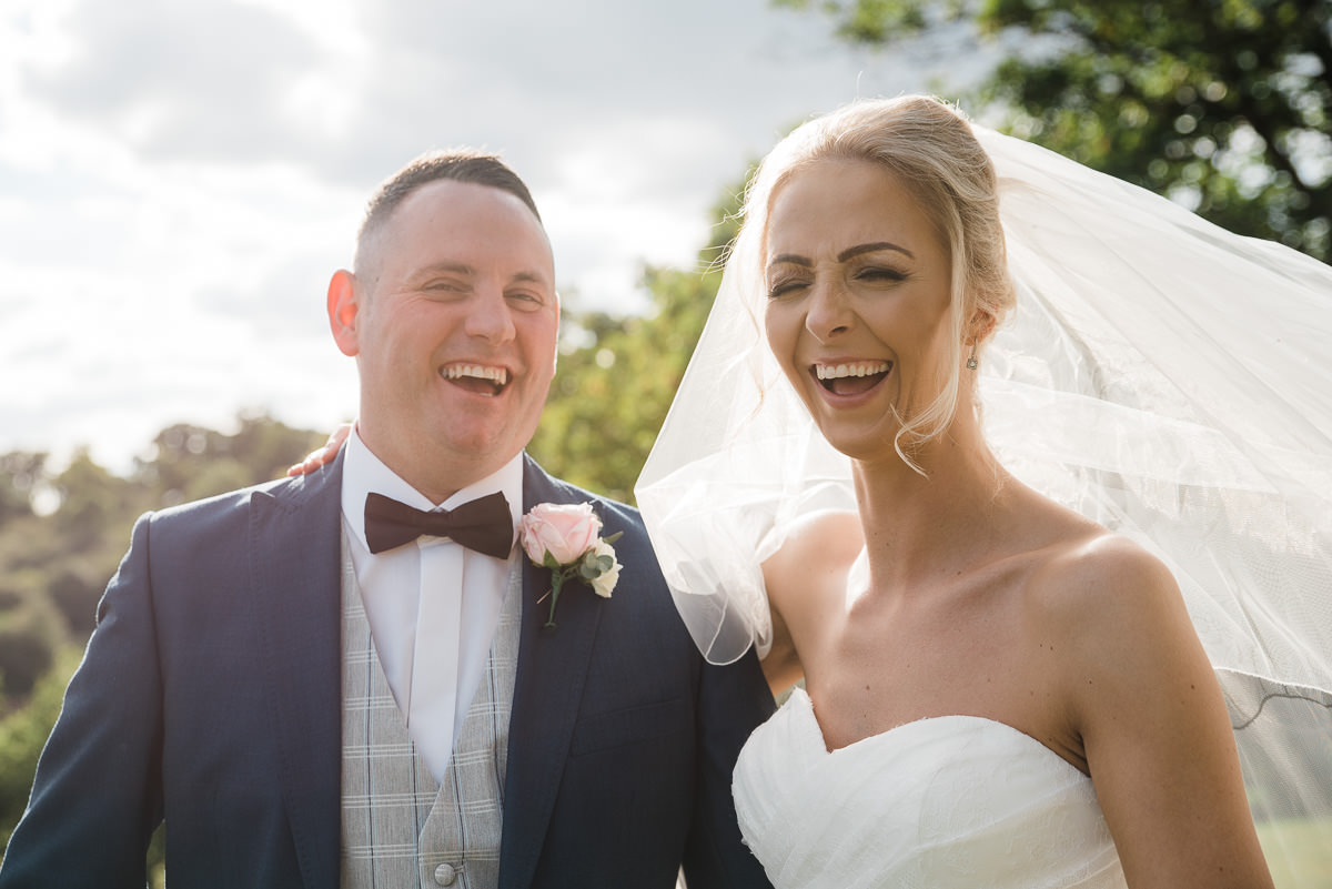 Candid joyous portrait of couple on their wedding date at The Welcombe Hotel