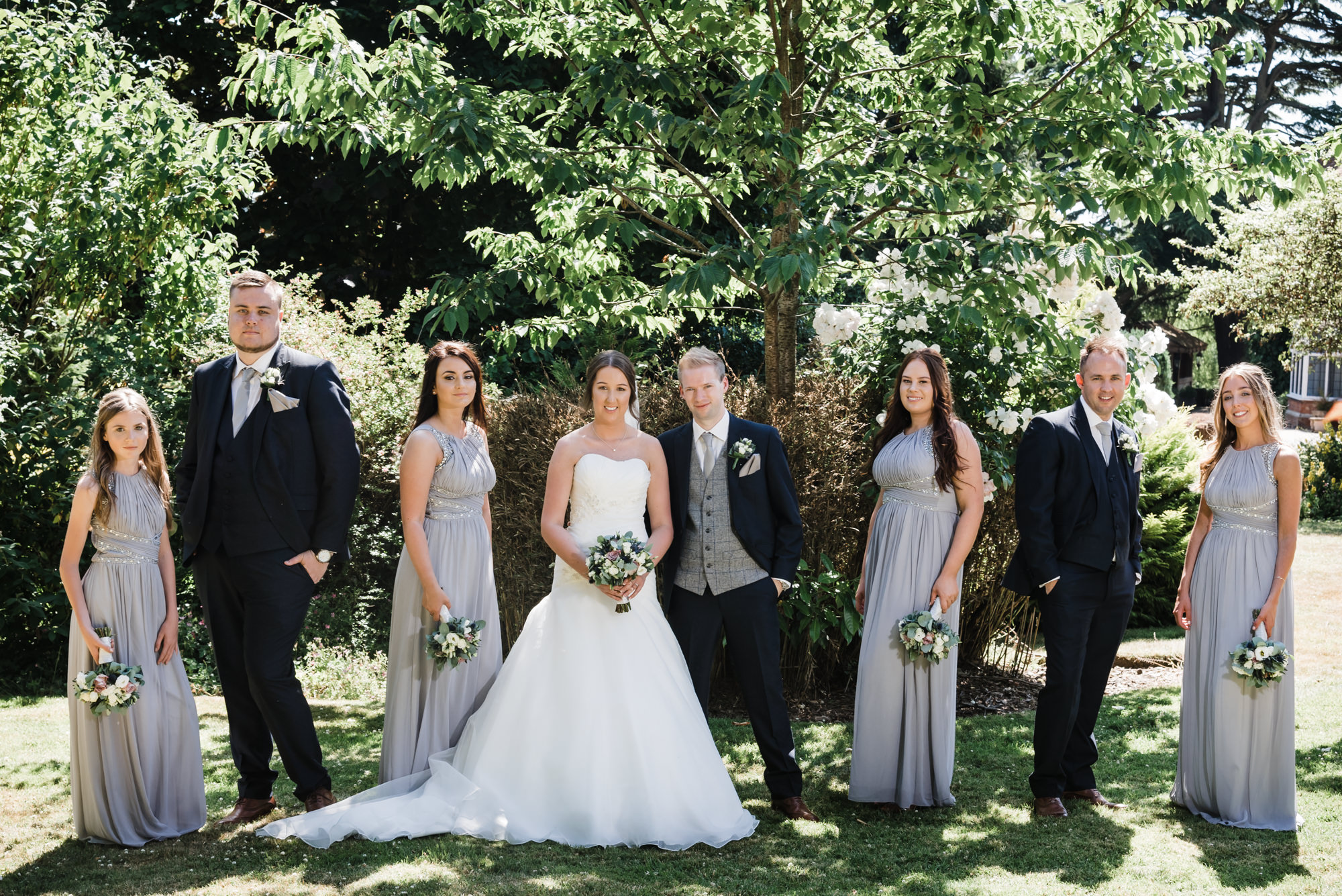 beautiful grey bridesmaid dresses with delicate bouquets