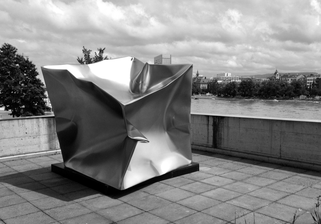Above : Ewerdt Hilgemann,  Imploded Cube , Stainless Steel, Private Collection