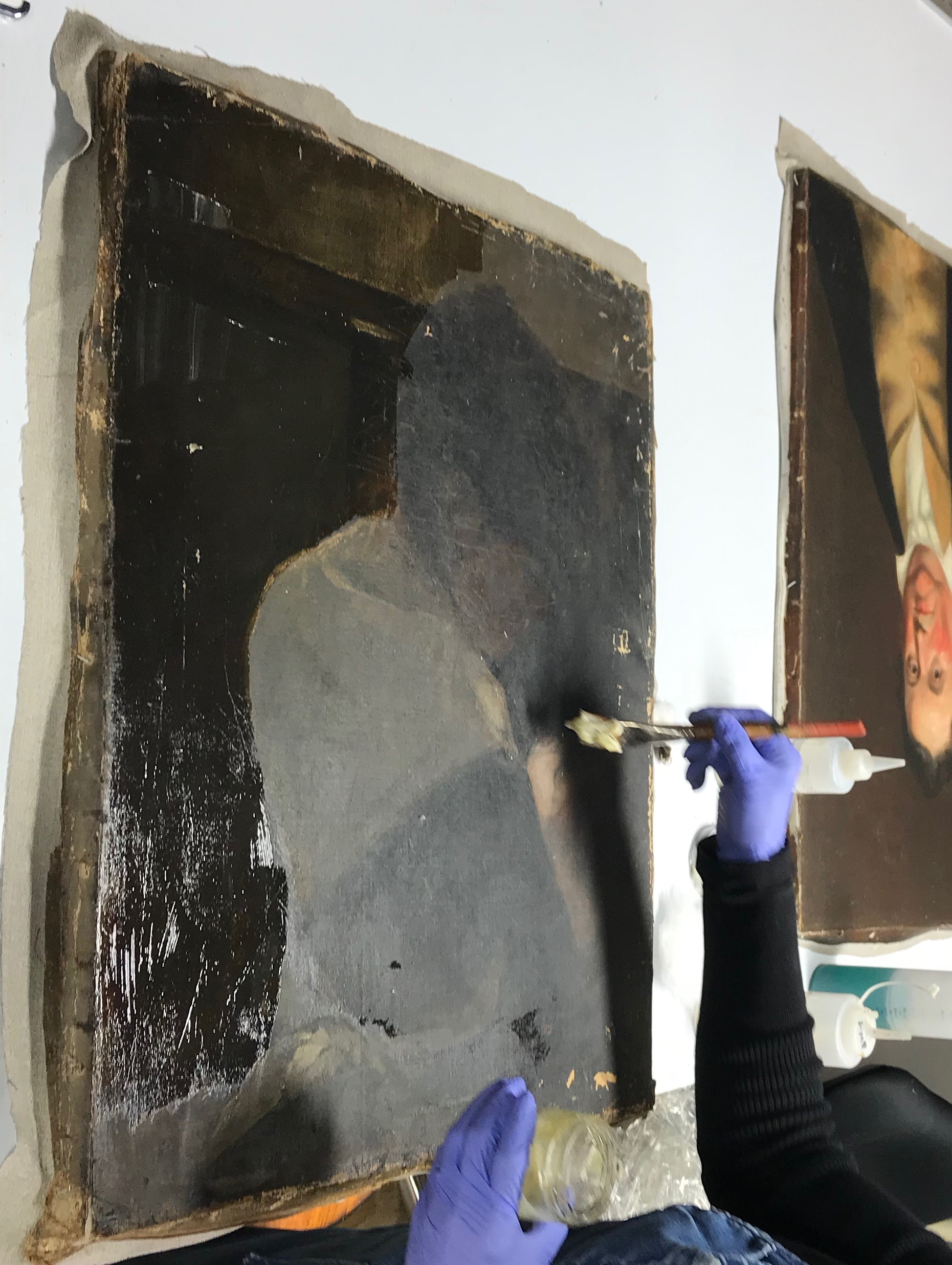 During Conservation Treatment, the surface is cleaned of soot, grime and nicotine accumulation.