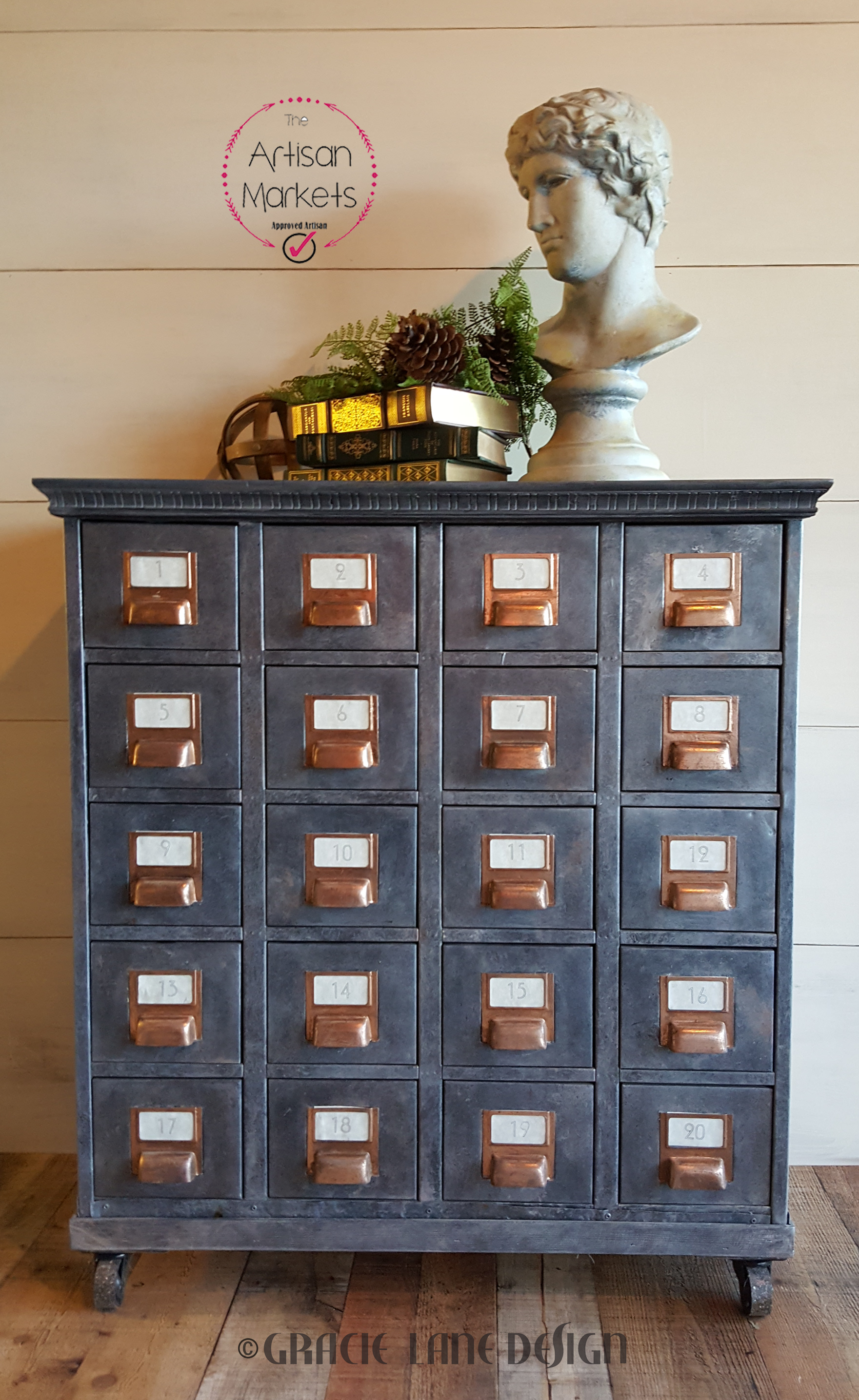 This vintage card catalog gets new life with a zinc finish, copper foil, wooden base and top and industrial casters.