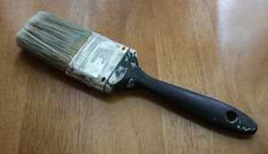 A brush like this: cheap and well-used will work fine.