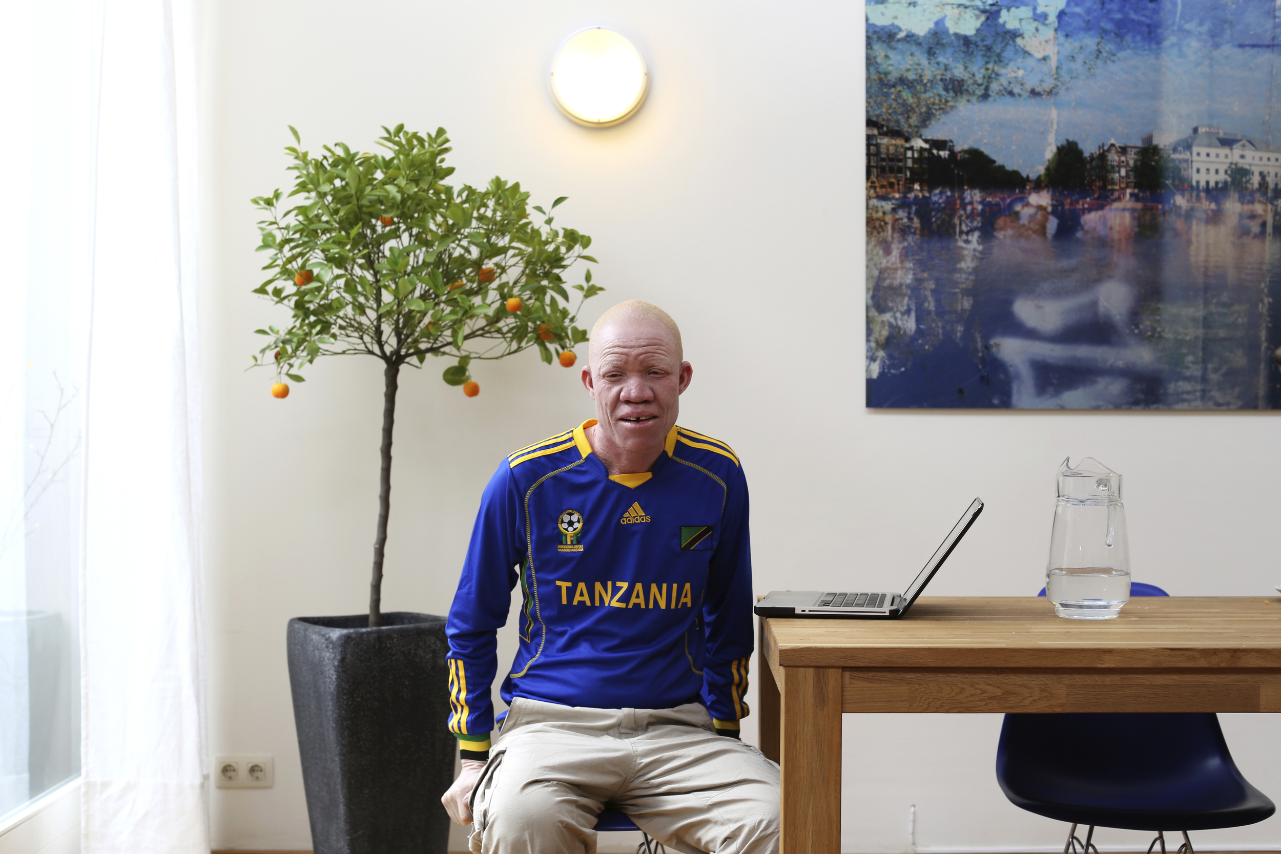 Before we met in person, he called me 'sister'. We do have a connection: he is an activist and the main subject of a documentary my brother made about the killings of people with albinism in Tanzania.  When I meet him for the first time in Amsterdam, I am already overwhelmed. Josephat is used to having his picture taken by now, although he doesn't seem to understand why I want to take it. He's partially blind, and I don't know if he can see me when I ask him to look at me. I only take a few shots.  He tells me I must use my photography to make great change in the world. I think about it.  I can't stop thinking about it.