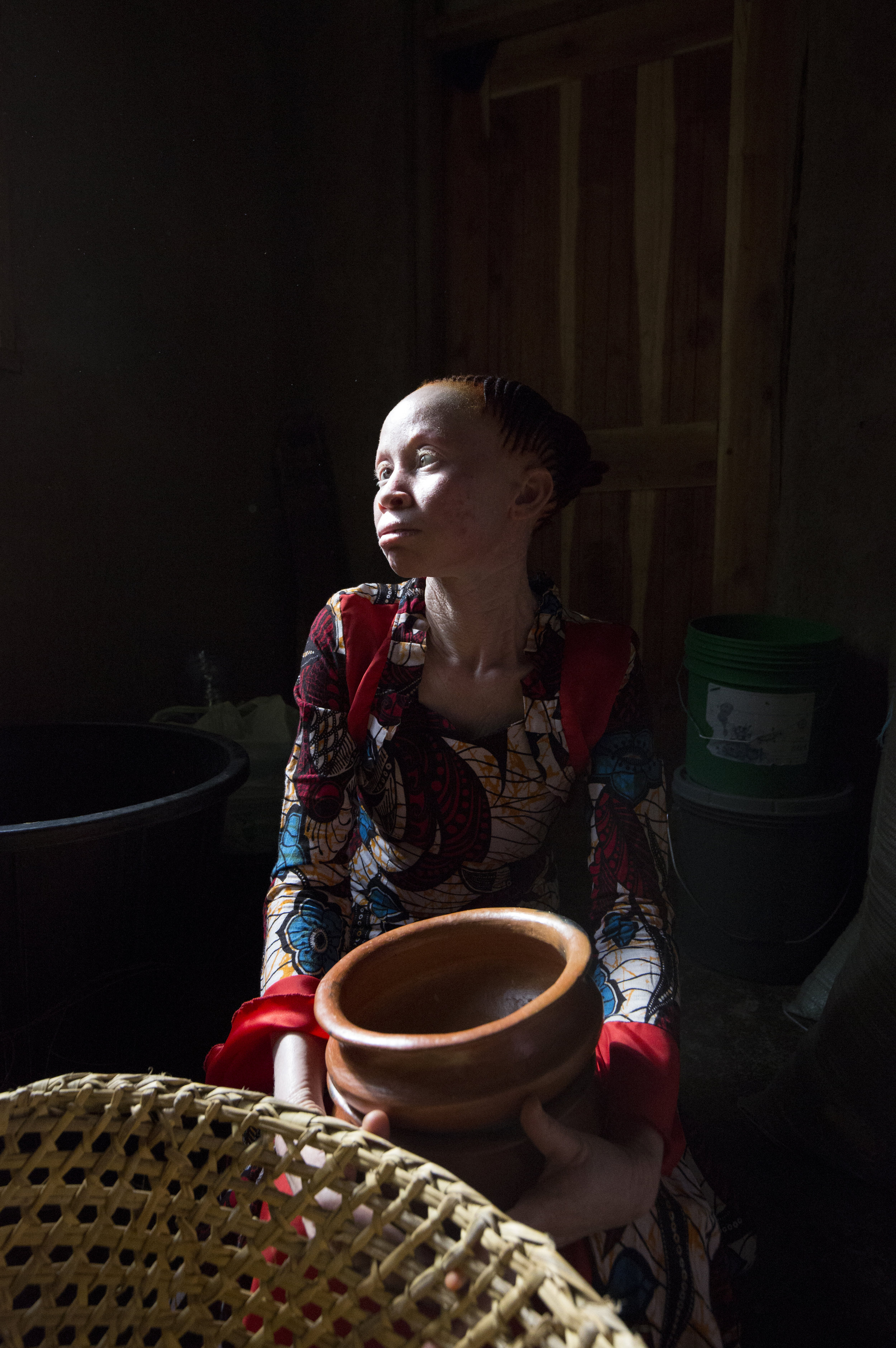 """Neema starts her own Pottery Business with the help of Charity Standing Voice. """"I make pots, stoves, and other kitchen utensils. My business does well. I am proud of the talent God has given me; it makes others realise that even a person with albinism can make it in this world."""""""