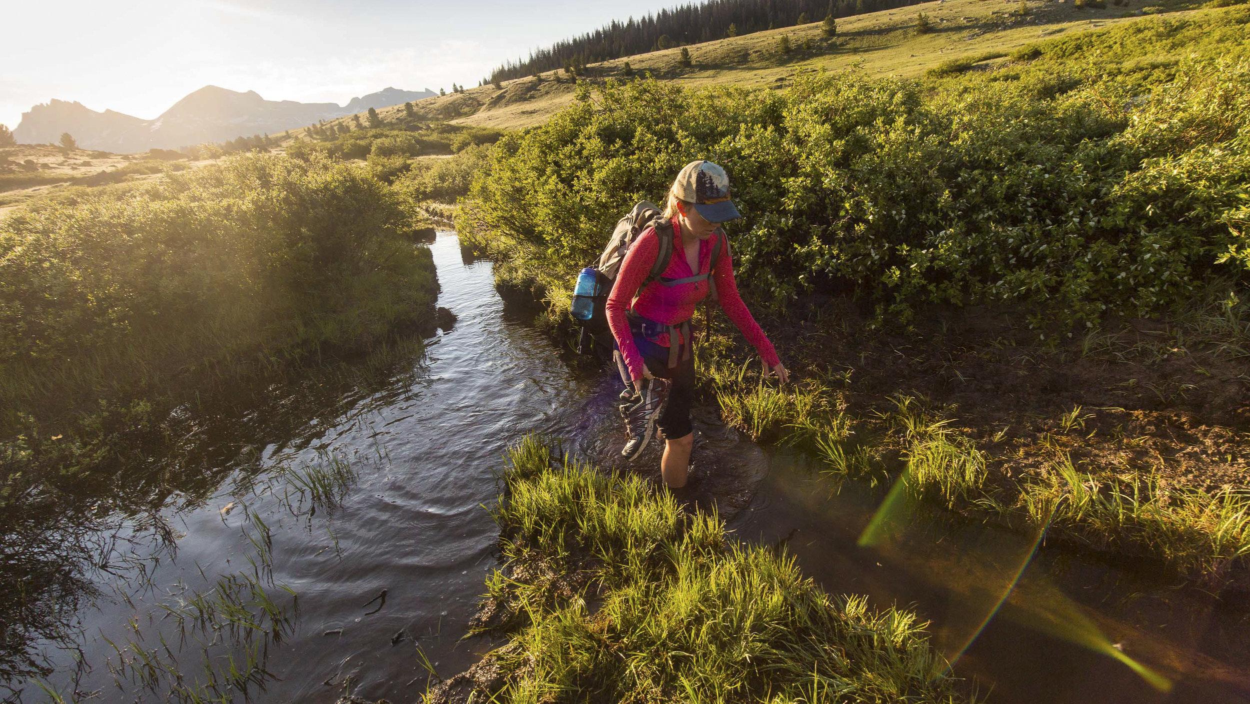 Ellen Slaton crossing the South Fork of Boulder Creek in the Wind River Range