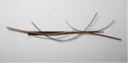 "John Schwartzkopf, ""Wedged Arc,"" 2012  paperstone, mahogany, various woods  21 1/2"" x 82"" x 5"""