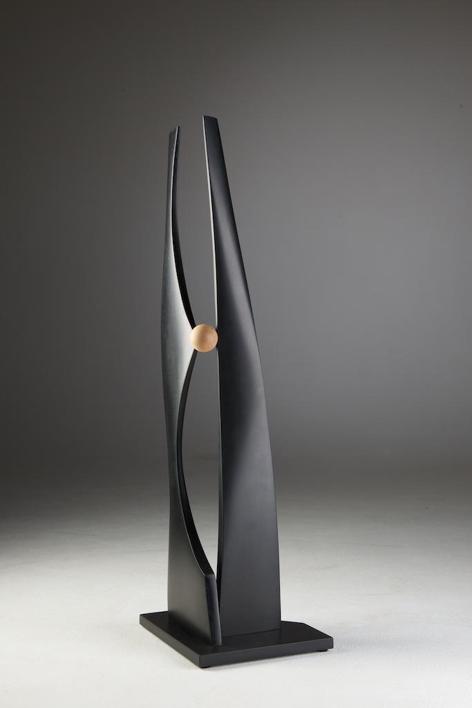 "John Schwartzkopf  (  BIO)   ""Geometric Tango,"" 2012  paperstone and maple  37"" x 12"" x 10"""